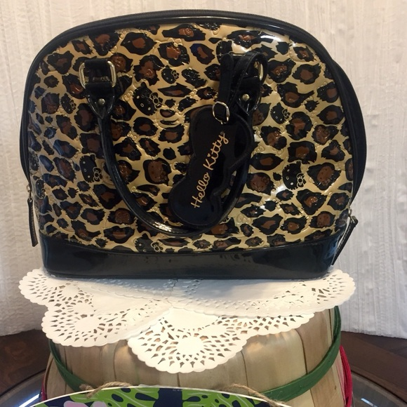 caac793ba34 Hello Kitty Bags   Domeshaped Leopard Purse Handbag   Poshmark